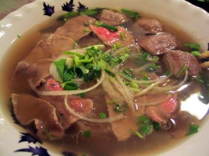 Pho Tai Bo Vien. Tastes better in Viet Nam where the broth base has been simmering in bone marrow since before the Fall of Saigon.