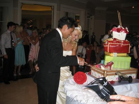 Best F'N wedding cake ever. 6 layers of stilettos, dumbbells, and high end luggage.
